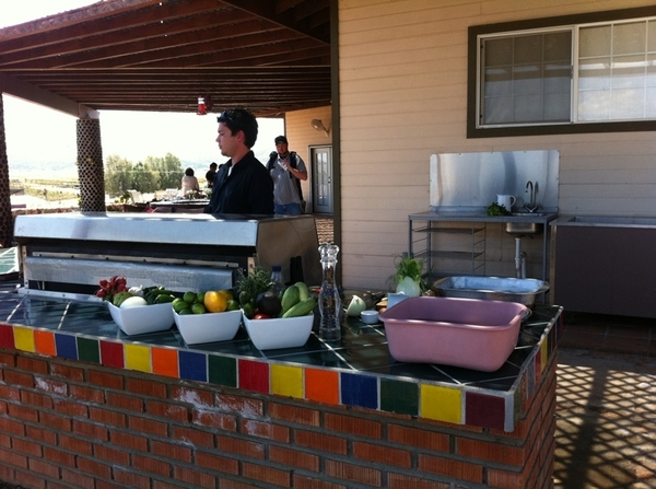 San Rafael Winery/Ojos Negros: setting up 4 cooking w/ chef/wine marker Luy Hussong in outdoor kitchen n vineyards