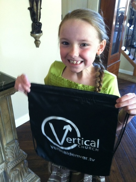Here is the stylish backpacks we gave out to the vkids this morning. Marley is my little model.