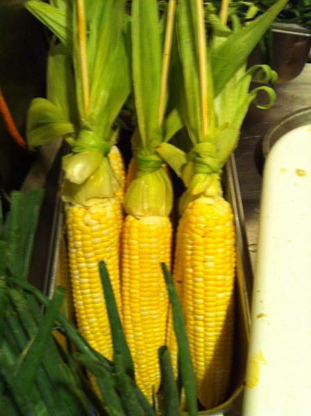 First local sweet corn from Three Sisters Garden, ready for wood grill. Topped w crema, queso aejo, chile