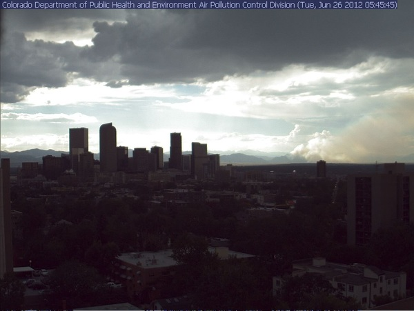 Great #photo of downtown #Denver, the enormous thunderstorm swelling above &amp; smoke from the #FlagstaffFire in #Boulder, #Colorado
