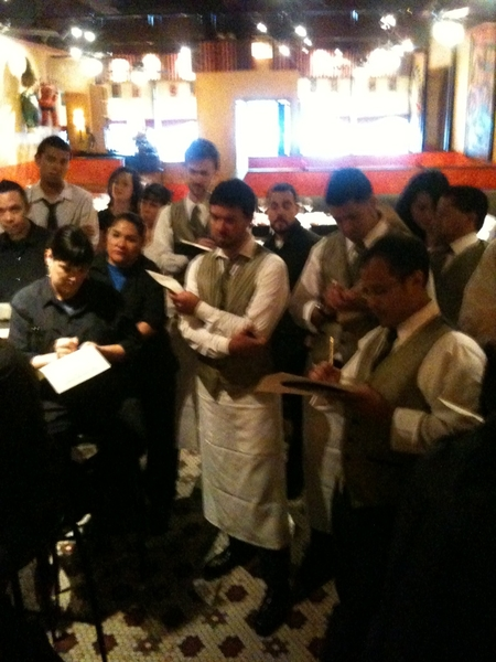 Frontera Farmer Foundation Dinner: service staff being briefed on details of menu