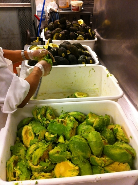 Cele making guac for lunch service in Frontera