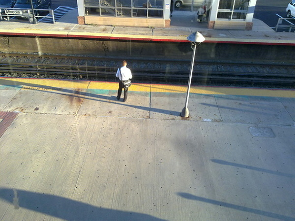 "Day 3 ""Charlie Sheen"" is checking his messages. On the north platform, someone is singing ""American Pie"" - again."