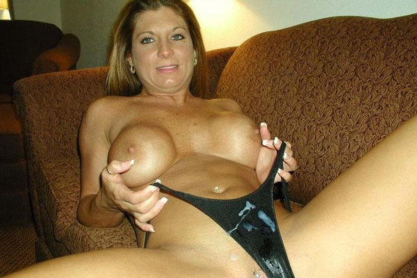hungry amateur seductress pleasing her shaved cunt with sex toys naked