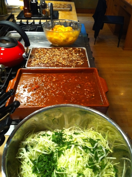 Making BBQ from my parents' resto for 15 friends: slaw fixins, baked beans, sheet cake, peaches for cobbler