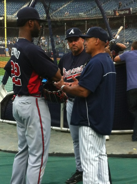 The traditional greeting to a visiting slugger by Reggie Jackson. Jason Heyward of the Braves (w/ Mgr. Fredi Gonzalez)