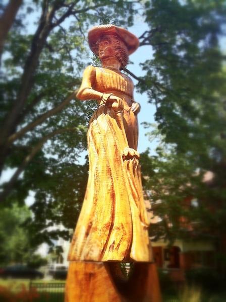 Lady well-covered for this hot & humid day in Orangeville  #WoodenTreeStatue