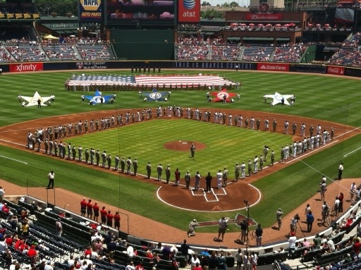 The pre-game ceremony saluting our troops with Braves and Cards lining the base paths with the military. #braves