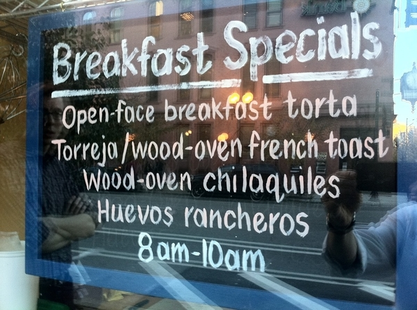 Sign is in the window at Xoco; new breakfast items are in full swing