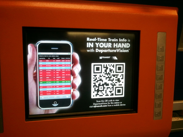 NJ Transit using QR Code to drive to mobile departure board info from ticketing kiosks. Very cool, but persistent QR Code would be even better.